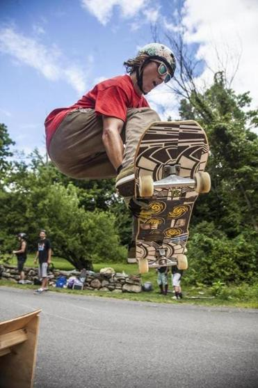 Skater Rob Wheeler catches air at last year's Central Mass. Longboard Festival in Harvard. This year's event takes place Aug. 7-9.
